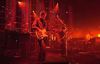Jun 27, 2001 - Mountain View, California, USA - Radiohead guitarist ED O'BRIAN, left, bass player COLIN GREENWOOD, center and THOM YORKE deliver a song to the sold-out crowd at the Shoreline Amphitheatre in Mountain View, Calif. (Credit Image: © Alan Greth)