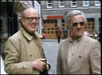 BNPS.co.uk (01202 558833)<br /> Pic: FrankWilliams/BNPS<br /> <br /> ****must use full byline****<br /> <br /> Screen grab of Frank Williams and John Le Mesurier.<br /> <br /> Never-seen-before film of the cast of Dad's Army behind the scenes has emerged to show Private Pike wasn't such a 'stupid boy' after all.<br /> <br /> The home movie footage captures actor Ian Lavender doing the Times crossword as he prepares to face the audience during the stage version of the classic BBC comedy.<br /> <br /> Dressed in his Home Guard uniform and with his trademark maroon scarf draped around his neck, the young actor is seen puffing on a cigarette with the paper on his lap.<br /> <br /> Although his character Pvt Frank Pike was a simple mother's boy, actor Ian was known to be the most intelligent member of the cast.