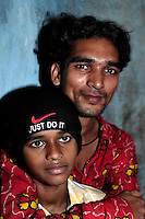 Two brothers in an alley in thr Dharavi slum on 12th Dec 2006.