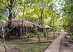 """Guest stay in well-appointed thatch-roofed """"villas"""" at the Siladen Resort and Spa, on Siladen Island off North Sulawesi, Indonesia."""