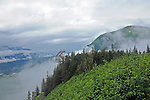 Cable car reaching the top of Mt Robert in Juneau Alaska.  Gastineau Channel is barely visible below through the low cloud cover on a July day
