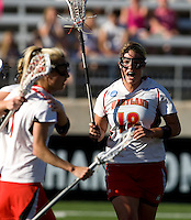 Karri Ellen Johnson (18) of Maryland celebrates a goal with her teammates during the NCAA Championship held in Johnny Unitas Stadium at Towson University in Towson, MD.  Maryland defeated Northwestern, 13-11, to win the title.