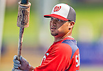23 February 2013: Washington Nationals catcher Jhonatan Solano awaits his turn in the batting cage prior to a Spring Training Game against the New York Mets at Tradition Field in Port St. Lucie, Florida. The Mets defeated the Nationals 5-3 in their Grapefruit League Opening Day game. Mandatory Credit: Ed Wolfstein Photo *** RAW (NEF) Image File Available ***