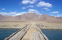 Bridge on Aksu river, on the road to the Marco Polo region..The M41 Highway from the Ismaili capital of Khorog to the south capital of Kyrgyzstan - Osh, via the head district of Badakhshan - Murgab and the Akbajtal Pass at 4655 meters.