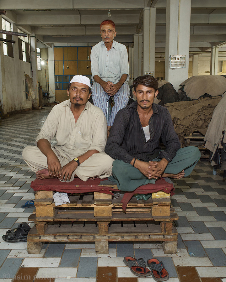 Factory workers between shifts take a break and a short rest.