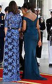 Samantha Cameron (L) and First lady Michelle Obama walk into the White House from the North Portico March 14, 2012 in Washington, DC. Cameron is on a three-day visit to the U.S. and he was expected to have talks with Obama on the situations in Afghanistan, Syria and Iran.  .Credit: Chip Somodevilla / Pool via CNP