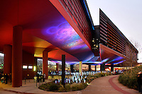 Bridge-like long gallery and Southern facade, Quai Branly Museum, 2007, by architect Jean Nouvel, Paris, France, reflecting the coloured lights of the garden. Picture by Manuel Cohen.