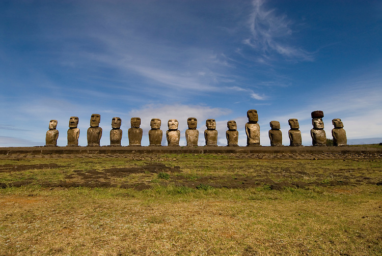 Chile, Easter Island: Array of statues or moai on a platform or ahu at Ahu Tongariki, near the quarry Rano Raruku.  This is the largest array of moia on Easter Island, consisting of 15 moai..Photo #: ch251-22859.Photo copyright Lee Foster www.fostertravel.com lee@fostertravel.com 510-549-2202