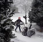NAUGATUCK, CT. 31 DECEMBER 01_NEW_123108DA02.jpg- Ben Ungrady, 10, of Naugatuck plows his neighbors driveway during Wednesday winter storm.<br />  Darlene Douty