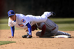 CHICAGO - APRIL  05:  Jeff Baker #28 of the Chicago Cubs is upended by Juan Miranda #26 of the Arizona Diamondbacks while recording a force out on April 5, 2011 at Wrigley Field in Chicago, Illinois.  The Cubs defeated the Diamondbacks 6-5.  (Photo by Ron Vesely) Subject: Jeff Baker;Juan Miranda