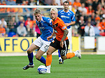 St Johnstone v Dundee United...27.08.11   SPL Week 5.Johnny Russell and Jamie Adams.Picture by Graeme Hart..Copyright Perthshire Picture Agency.Tel: 01738 623350  Mobile: 07990 594431