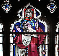 Stained glass window of St Theresa, 1943, by Hollart, master glazier of Houle et Fleury, in the Collegiale Notre-Dame de Poissy, a catholic parish church founded c. 1016 by Robert the Pious and rebuilt 1130-60 in late Romanesque and early Gothic styles, in Poissy, Yvelines, France. The Collegiate Church of Our Lady of Poissy was listed as a Historic Monument in 1840. Picture by Manuel Cohen