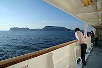 Cruising the Izu Islands on one of the many ferries that ply these waters from either Tokyo or Shimoda. Off in the background is Niijima, one of the more popular of the islands for its beaches and powerful surf.
