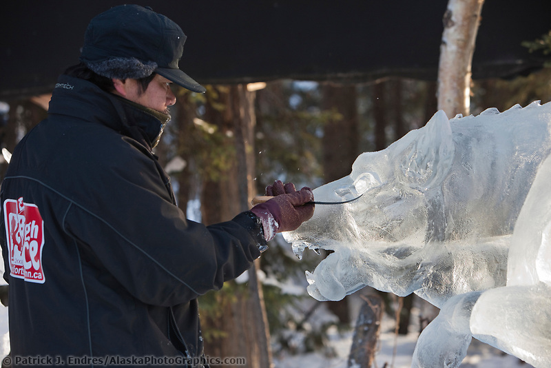 "Takao Waki, Japan, works on the details of an attacking wolf for the multi block sculpture titled ""White Fang"" for the 2009 World Ice Art Championships in Fairbanks, Alaska. Team members: Junichi Nakamura, Shinichi Sawamura, Fukumi Furukawa, Takao Waki."