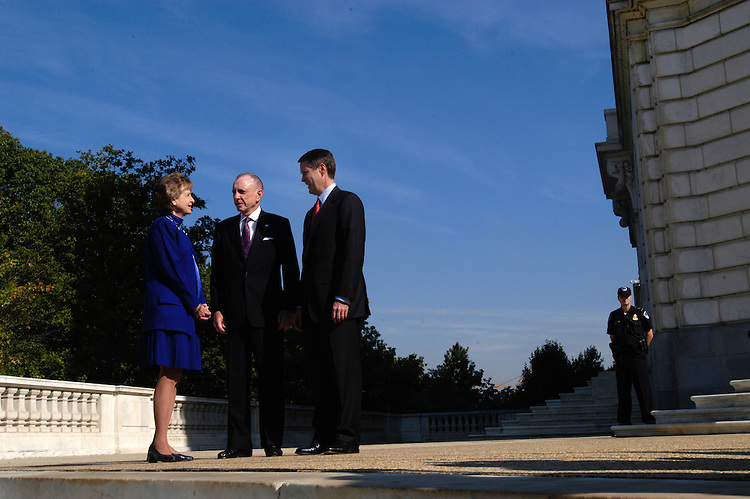 Senate Majority Leader Bill Frist (R), R-Tn., and Sen. Arlen Specter (C), R-Pa., greet Supreme Court nominee Harriet Miers as she arrives at the Capitol.