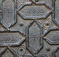 Architectural detail of the door of the Puerta del Perdon or Door of Forgiveness, built 1377 and renovated 17th century, one of the North facade entrances to the Cathedral-Great Mosque of Cordoba, on the Calle Cardenal Herrero in Cordoba, Andalusia, Southern Spain. This is a fine example of Mamluk metalwork, with a geometric pattern of hexagonal metal plaques and stars. The first church built here by the Visigoths in the 7th century was split in half by the Moors, becoming half church, half mosque. In 784, the Great Mosque of Cordoba was begun in its place and developed over 200 years, but in 1236 it was converted into a catholic church, with a Renaissance cathedral nave built in the 16th century. The historic centre of Cordoba is listed as a UNESCO World Heritage Site. Picture by Manuel Cohen