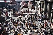 Naga sadhus seen alongside the Hindu pilgrims inside the Pashupathi Nath Temple in capital Kathmandu, Nepal