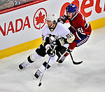 21 September 2009: Pittsburgh Penguins' defenseman Kris Letang (58) is checked by Ben Maxwell (61) during a pre-season game against the Montreal Canadiens at the Bell Centre in Montreal, Quebec, Canada. The Canadiens edged out the defending Stanley Cup Champions 4-3. Mandatory Credit: Ed Wolfstein Photo