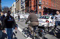 Pedestrians, bicyclists, pedicabs, and police cars mixed on Pennsylvania Avenue near the White House on Sunday, January 20, 2013 in Washington, DC.
