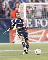New England Revolution defender Darrius Barnes (25) passes the ball. In a Major League Soccer (MLS) match, the New England Revolution (blue) defeated Chicago Fire (red), 1-0, at Gillette Stadium on October 20, 2012.