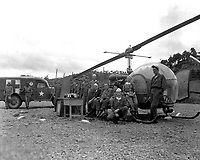 Personnel and equipment needed to save a man'life are assembled at HQs of the 8225th Mobile Army Surgical Hospital, Korea.  October 14, 1951.  Cpl. Charles Abrahamson.  (Army)<br /> NARA FILE #  111-SC-382662<br /> WAR &amp; CONFLICT BOOK #:  1457