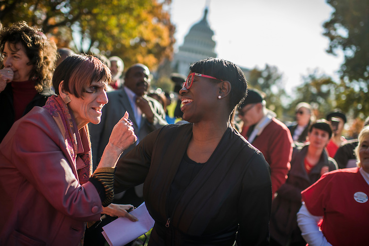 UNITED STATES - NOVEMBER 17: Rep. Rosa DeLauro, D-Conn., left, and Nina Turner, attend a rally held by labor, environmental, and consumer groups in Upper Senate Park featuring an address by Sen. Bernie Sanders, I-Vt., to call for economic and social justice, November 17, 2016. (Photo By Tom Williams/CQ Roll Call)