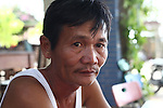 "Nguyen Tan Hoa, 55, sits outside his guesthouse near Da Nang, Vietnam. Hoa was 10 when U.S. Marines from a Combined Action Platoon moved into his village during the Vietnam War. For the next three years, he spent most of his time with the Marines and still refers to himself proudly as one of them. ""Whatever they got, I got,"" he says. ""We shared everything."" When Saigon fell to North Vietnamese forces in 1975, ""I really felt like I was the last G.I. in Vietnam,"" he says. Aug. 10, 2012."