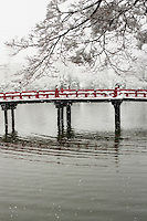 The vermilion bridge that crosses Matsumoto Castle Moat on a snowy winter day.