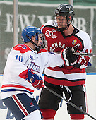 Ryan McGrath (UML - 10), Dax Lauwers (NU - 44) - The Northeastern University Huskies defeated the University of Massachusetts Lowell River Hawks 4-1 (EN) on Saturday, January 11, 2014, at Fenway Park in Boston, Massachusetts.