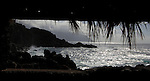 Surf breaking on rugged El Hierro coastline looking through shelter,Canary islands.