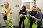 July 11, 2012; Jennifer Ottman, administrative assistant, (left) gives a tour to Notre Dame employees during the grand opening of the Notre Dame Wellness Center. Photo by Barbara Johnston/University of Notre Dame