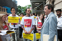 Members of Amnesty International, joined by activist lawyer Norman Siegel, right, stand near the Russian Consulate in New York on Friday, July 27, 2012 calling for the release from excessive detention of three members of the female Russian punk band Pussy Riot. Nadezhda Tolokonnikova, Maria Alekhina and Yekaterina Samutsevich.  members of the band have been held in pre-trial detention since March of this year after protesting against Russian President Putin via an unauthorized performance in the Christ the Saviour Cathedral in Moscow. They face up to seven years in jail on hooliganism charges. . (© Richard B. Levine)