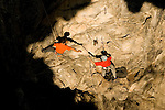 Rock climbing in a cave at Crazy Horse, a crag near Chiang Mai, Thailand.