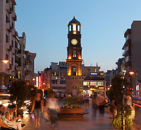 Historical clock tower seen in the evening in Canakkale town centre, Turkey. Canakkale is on the southern (Asian) coast of the Dardanelles. The clock tower or Saat Kulesi is a five story Ottoman construction near the harbour and was built in 1897. It was paid for by an Italian consul and Canakkale merchant who left 100,000 gold francs in his will for this purpose. Picture by Manuel Cohen