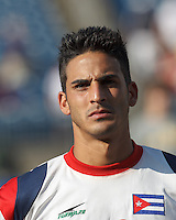 Cuban defender Jorge Corrales (13). In CONCACAF Gold Cup Group Stage, the national team of Cuba (white) defeated national team of Belize (red), 4-0, at Rentschler Field, East Hartford, CT on July 16, 2013.
