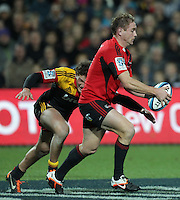 Chiefs' Tawera Kerr-Barlow tackles Crusaders' Andy Ellis in a Super Rugby match, Waikato Stadium, Hamilton, New Zealand, Friday, July 06, 2012.  Credit:SNPA / David Rowland