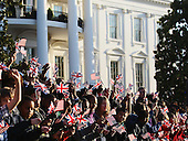 Crowds await the arrival of British Prime Minister David Cameron at the official arrival ceremony on the South Lawn of the White House March 14, 2012 in Washington, DC. Prime Minister Cameron was on a three-day visit in the U.S. and he was expected to have talks with President Obama on the situations in Afghanistan, Syria and Iran.  .Credit: Mark Wilson - Pool via CNP