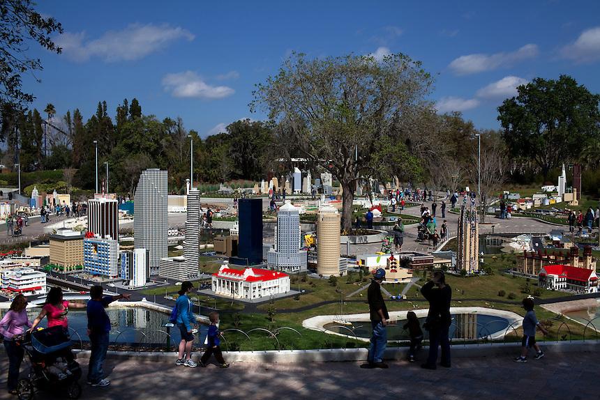 People walk through Miniland in Legoland in Whitehaven, Florida on February 11, 2012.