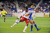 Dane Richards (19) of the New York Red Bulls plays the ball as Stephane Auvray (8) of the Kansas City Wizards defends. The New York Red Bulls defeated the Kansas City Wizards 1-0 during a Major League Soccer (MLS) match at Red Bull Arena in Harrison, NJ, on October 02, 2010.
