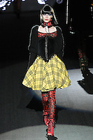 Martyna walks runway in an Underneath It All outfit, from the Betsey Johnson Fall 2011 He Loves Me Not - Black Tag collection, during Mercedes-Benz Fashion Week Fall 2011.
