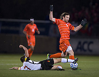 Dan Metzger (7) of Maryland tackles Thomas McNamara (5) of Clemson during the ACC tournament semifinals at the Maryland SoccerPlex in Boyds, MD.  Maryland defeated Clemson, 1-0, in overtime.