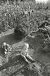 Tolston Wild playing in garden dirt. 1973. 2 years old. File #73-148-18