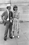Posh young couple with bottle of Pimms about to go to the Eton harrow annual cricket match at Lords cricket ground. St Johns Wood London 1978,
