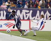 Second half substitute Kansas City Wizards defender Jonathan Leathers (25) trips up New England Revolution midfielder Kenny Mansally (7). The New England Revolution defeated Kansas City Wizards, 1-0, at Gillette Stadium on October 16, 2010.