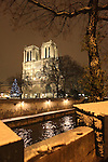 Paris, France , and continental Europe is gripped by heavy snow and arctic conditions in the run up to Christmas December 2010. Transport is just about brought to a standstill, with airports and train stations closed down or running slow. On the other hand Paris is rarely snowbound and as such  is idyllic and remains an attraction to tourists and local Parisiens alike.//Notre Dame Cathedral and the river seine in the snow at night