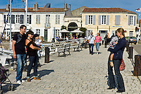 Tourists taking photographs at Quai Job Foran, St Martin de Re on Ile de Re in France