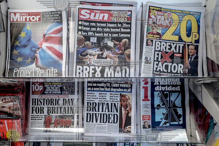 The front pages of tabloid newspapers showing the first edition headlines printed before the outcome of the EU referendum was clear.