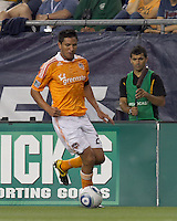 Houston Dynamo forward Brian Ching (25) brings the ball forward. In a Major League Soccer (MLS) match, the New England Revolution tied Houston Dynamo, 1-1, at Gillette Stadium on August 17, 2011.