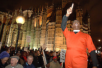 Christians hold a rally outside the House of Lords during a debate to pass legislation to give gay people the rights as the rest of society. There was a small counter demonstration by gay activists..
