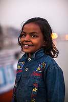 Priya, 8, poses for a portrait on the Boat School Guria runs on the holy Ganges River, in Varanasi, Uttar Pradesh, India on 19 November 2013. The school, accommodating almost 50 children, aims to take the boatmen's children away from working in the tourist areas where they are exposed to trafficking and sexual abuse.